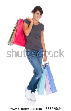 Happy Young Woman Holding Shopping Bag Over White Background - stock photo