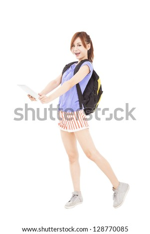happy young woman holding tablet pc - stock photo