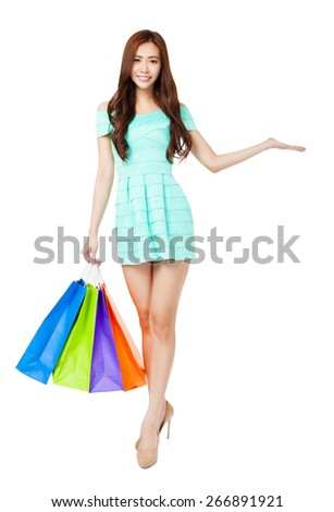 happy young woman holding the shopping bags - stock photo