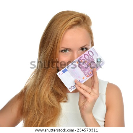 Happy young woman holding up cash money five hundred euro in one note in hand smiling and looking at the camera isolated on a white background - stock photo
