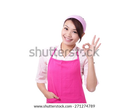 Happy young woman housewife mother wearing kitchen apron and showing OK, asian - stock photo