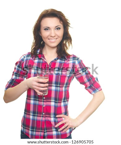 Happy young woman in a plaid shirt. Woman holds a glass of water. Isolated on white background