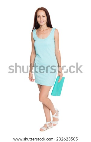 Happy young woman in a turquoise summer dress. Girl of twenty-seven years. - stock photo