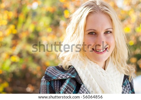 happy young woman in autumn forest - stock photo