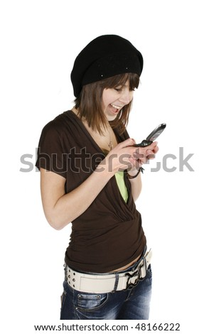 Happy young woman in black beret using cell phone isolated on white background - stock photo