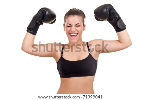 Happy young woman in boxing gloves, with her hands up-isolated on white