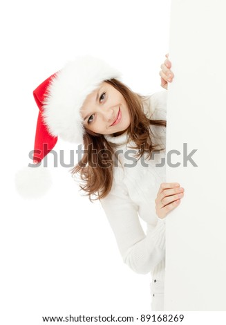 happy young woman in Christmas Santa's hat holding big banner for your advertisement isolated on white - stock photo