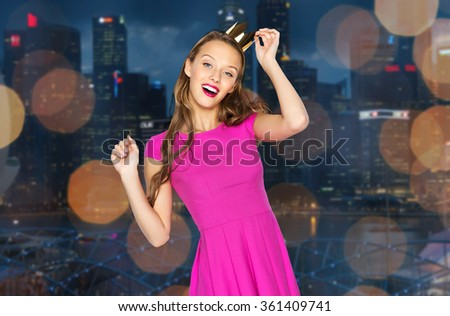 happy young woman in crown over night city  - stock photo
