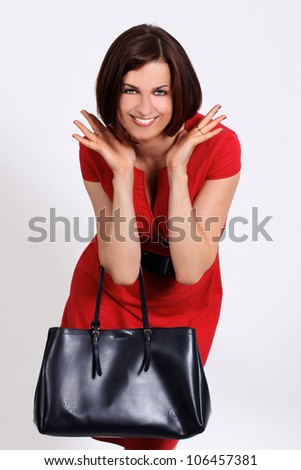 Happy young woman in red dress. - stock photo