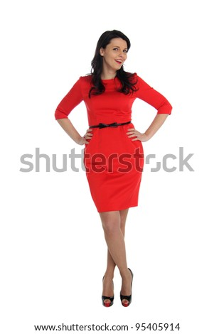 Happy young woman in red dress. Isolated over white background.