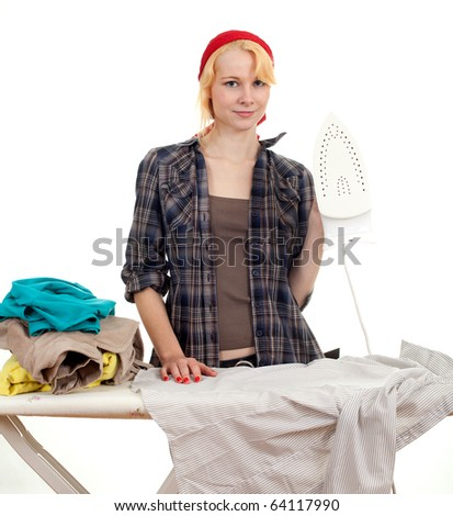 happy young woman in red headscarf ironing clothes, housework - stock photo