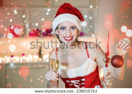 Happy, young woman in Santa Claus costume holding a glass of champagne and toasts Christmas holidays.Shallow doff, bokeh light - stock photo