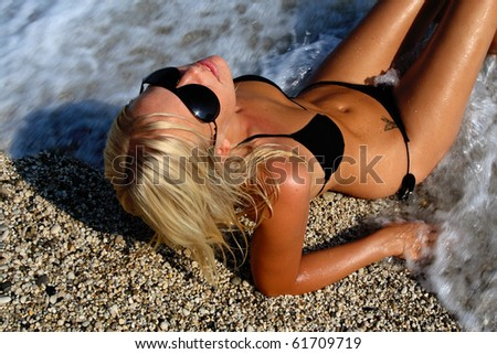 Happy young woman in sea in greece - stock photo