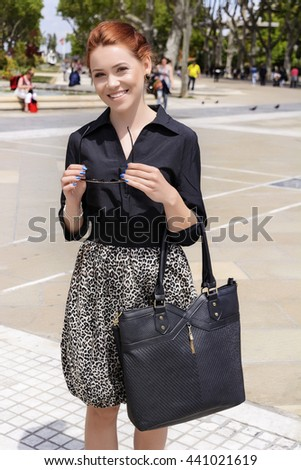 Happy young woman in the boulevard - stock photo