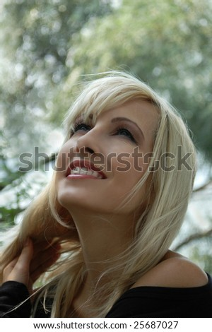 Happy young woman in the park - stock photo