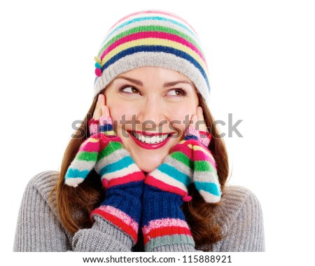 Happy young woman in the warm clothing, colorful mittens and hat. Isolated on white background, mask included