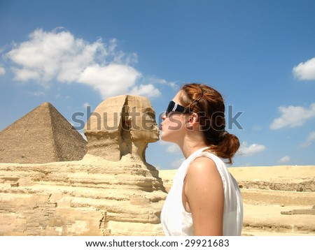 Happy young woman in white dress is kissing Sphinx in Giza in Cairo  Egypt - stock photo