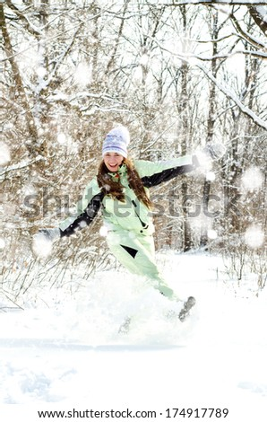 happy young woman in winter outdoors