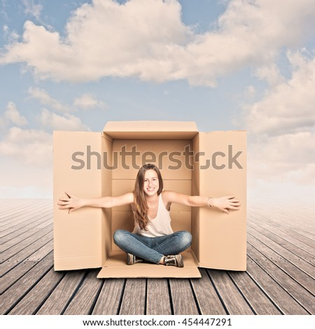 happy young woman inside a Box on a pier