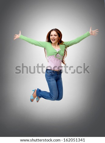 happy young woman is jumping - stock photo