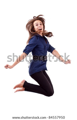 Happy young woman jumping in white background - stock photo