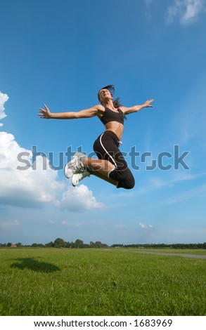happy young woman  jumping on a sunny day - stock photo