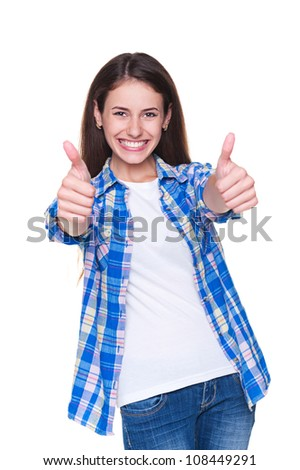 happy young woman laughing and showing thumbs up over white background - stock photo