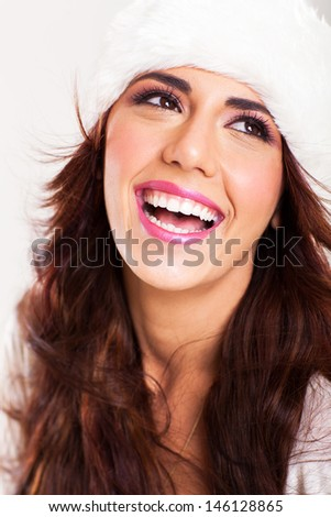 happy young woman laughing on white background