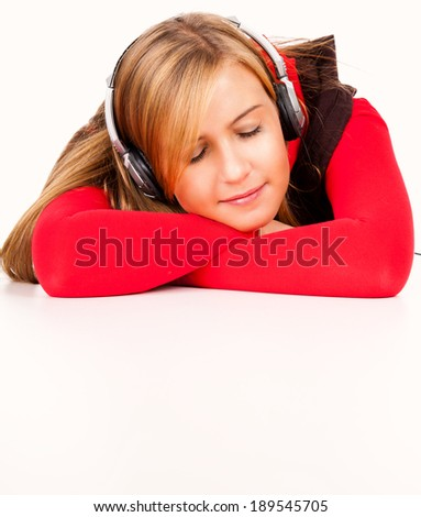 Happy young woman listening to music, white background - stock photo