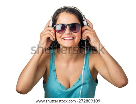 Happy young woman listening to music with white headphones - stock photo