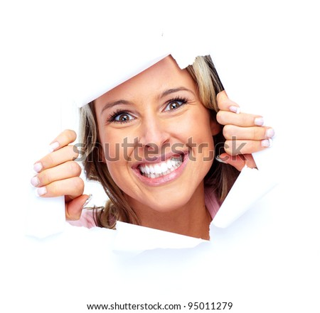 Happy young woman looking through a hole. Isolated on white background. - stock photo