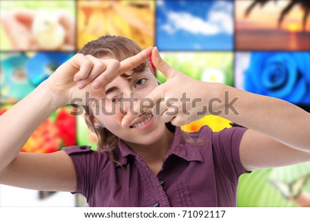 Happy young woman making a frame with her hand - stock photo