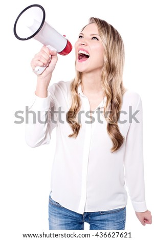 Happy young woman making announcement in  loudhailer - stock photo