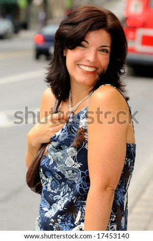 Happy Young Woman On A City Street - stock photo