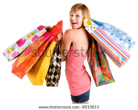 Happy Young Woman on a Shopping Spree - stock photo