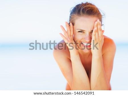 Happy young woman on beach having fun - stock photo