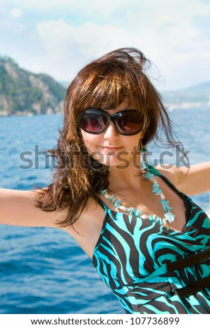Happy young woman on holidays on the sea - stock photo