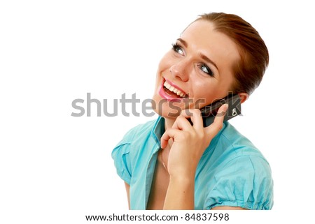 Happy young woman on mobile phone isolated on white - stock photo