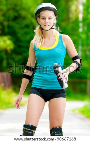 happy young woman on roller skates in the park