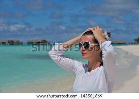 happy young woman on summer vacation on beautiful tropical beach have fun enjoy and relax - stock photo