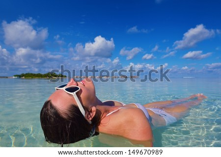 happy young woman on summer vacation on beautiful tropical beach have fun enjoy and relax