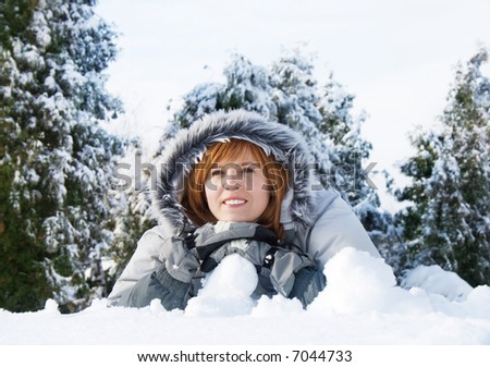 happy young woman on the snow - stock photo