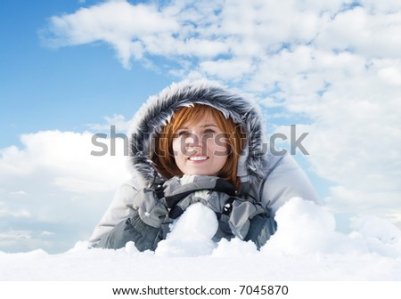 happy young woman on the snow against blue sky - stock photo
