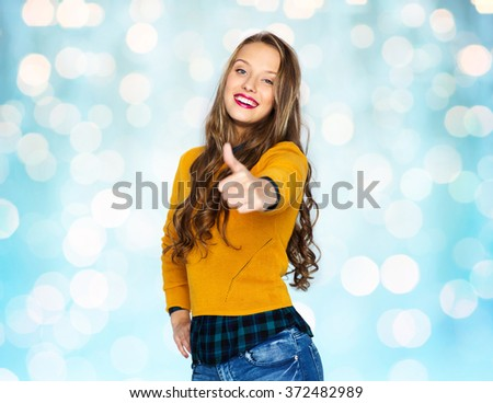happy young woman or teen girl showing thumbs up - stock photo