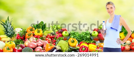 Happy young woman over healthy diet background. - stock photo