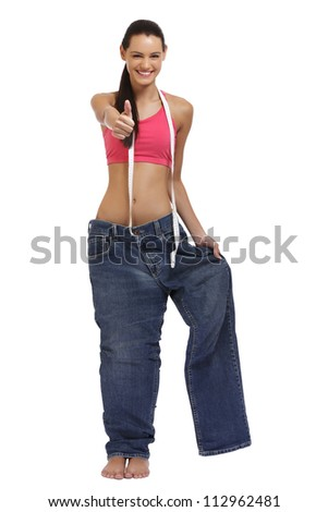 happy young woman posing in a big trousers - stock photo