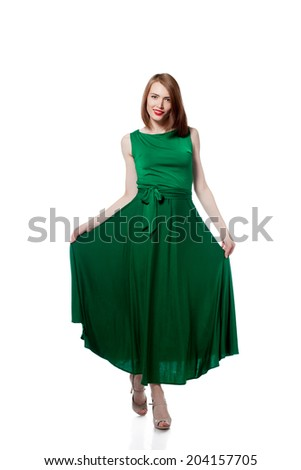 Happy young woman posing in bright green dress - stock photo