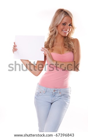 Happy young woman posing with white board. Isolated