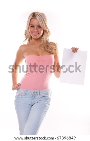 Happy young woman posing with white board. Isolated - stock photo