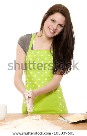 happy young woman preparing dough for baking on white background - stock photo